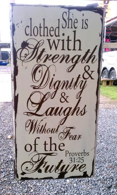 Proverbs 31 verse, she is clothed with strength and dignity, great for that wonderful woman in your life, vintage distressed sign. $35.00, via Etsy. ------i really love this!