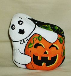 My painted rock, Halloween ghost and pumpkin.