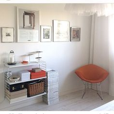 Lovely String display with some orange colour splash. Photo by String Shelf, String System, Shelving Systems, Work Desk, Storage Design, Storage Shelves, Color Splash, Orange Color, Flooring