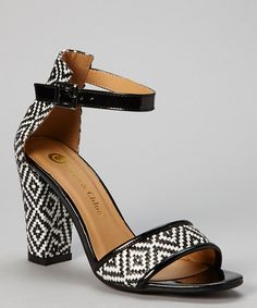 Pump up any look with '60s inspired heels. The chunky straps and heel make for a vintage-evoking showstopper.