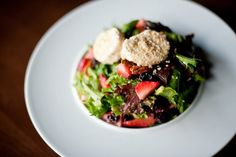 Goat Cheese, Strawberry and Pecan Salad - field greens, sesame crusted goat cheese, strawberries, dried cherries, spiced pecans, strawberry poppy seed dressing