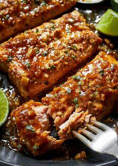 This Spicy Honey Garlic Salmon is perfect for a quick weekday evening: smother your pan seared salmon fillets with a garlic honey mustard glaze and dinner is ready in under 20 minutes! This Spicy Honey Garlic Salmon is pe Salmon Dishes, Fish Dishes, Seafood Dishes, Seafood Recipes, Spicy Dishes, Spicy Salmon, Garlic Salmon, Pan Seared Salmon, Smoked Salmon