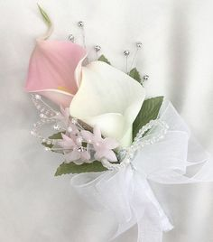 Ladies Pin On Corsage with Baby Pink andWhite Calla lilies with. This stunning corsage has been made using artificial baby pink and white calla lilies. The stem has then been wrapped in white ribbon with a white ribbon bow. Lily Bouquet Wedding, Neutral Wedding Flowers, Calla Lily Bouquet, Winter Wedding Flowers, Rustic Wedding Flowers, Corsage Wedding, Wedding Flower Arrangements, Calla Lilies, Artificial Wedding Flowers