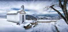 Small church on snowy hills in northern Italy - In Northern Italy, in the Veneto region, there are the Euganean Hills, a group of volcanic hills. It is a special place, full of vegetation and fauna of great scientific interest. In winter snow covers this territory sometimes turning it into a mystical and enchanted landscape, and offering a spectacular view for those who go there.
