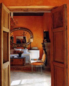 Lovely orange bedroom, wood double doors, modern and old focus-damnit:Casa Midy