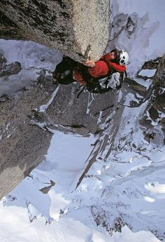 Alpinist Nancy Feagin makes the final moves on Chamonix's famous climb the Frendo Spur, on the North Face of the Aiguille du Midi. Chamonix Alps, France.
