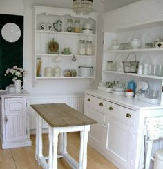 The Little White House On The Seaside:   Love kitchens made up of furniture pieces instead of built ins.  So pretty!