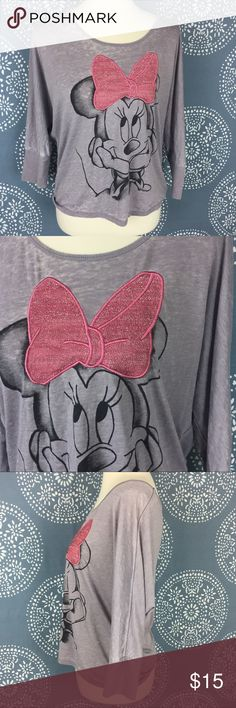 """Disneyland Resort Minnie Mouse Slouchy Top Cute Minnie Mouse Disneyland Resort tee in a gray burnout color. Minnie's bow is pink and glittery. It has a loose, slouchy fit, and the sleeves are 3/4 length. Great used condition. 21.5"""" armpit to armpit and 23"""" long. Disney Tops Tees - Short Sleeve"""