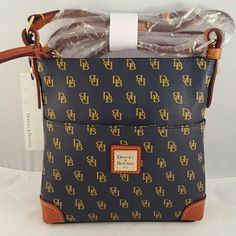 "(NEW) Authentic Dooney & Bourke Purse Smoke and pet free home. H 8.25"", W 2"", L 8.25"", 26"" strap drop. Has an ouside, inside, and cell phone pocket along with an inside key hook. Lined zipper closure and coated cotton fabric. No dust bag. I'm sorry but i dont trade. Dooney & Bourke Bags Crossbody Bags"