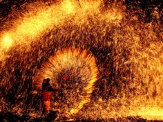 Picture of man creating light show with molten iron, Lantern Festival, China