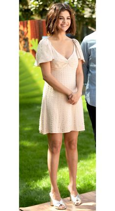 Selena Gomez in a blush mini dress and mules