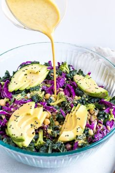 A crunchy kale and cabbage salad with broccoli florets, chickpeas and sunflower seeds all coated with a light nutritional yeast dressing. Vegan, gluten-free and paleo! #vegan #paleo #salad #kale #avocado #healthyrecipe