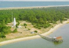 North Island Lighthouse - Winyah Bay  The first house, as early as 1795, burned whale oil in a six foot wide lantern. The second light was destroyed during the Civil War. Our current light is 85 ft tall and was one of the last manual lighthouses.  Accessible by boat only.