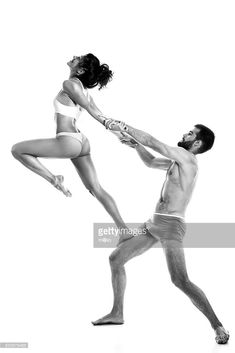 Stock Photo : Couple performing acro-yoga exercise in studio Fit Couples, Acro, Portrait Inspiration, Royalty Free Images, Yoga Fitness, Boudoir, Exercise, Photoshoot, Stock Photos
