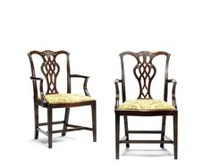 A pair of George III mahogany open armchairs (2)