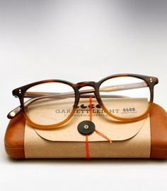Very classic glasses frame design and colors and equally distinctive packaging...from Garrett Leight Kinney - Dark Caramel Gradient..very sharp.