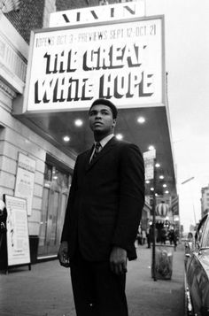 """Not published in LIFE. Muhammad Ali outside the Alvin Theater where James Earl Jones is starring in the play """"The Great White Hope,"""" New York, 1968. 
