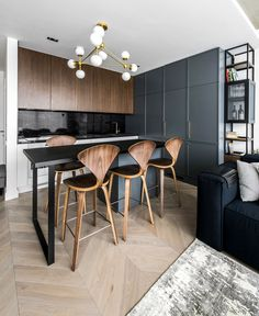 gorgeous wooden parquet (that subsequently goes throughout the premises of the apartment), the furniture is a mixture between trendy dark and black textures and fashionable wood additions Modern Comfort and Luxury at apartment Designed by Interjero Architektura - InteriorZine