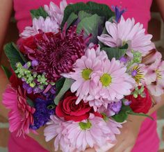 Hot pink bridesmaids bouquets by Dew Drop Flower Shoppe in Seville, Ohio