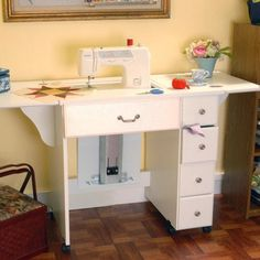 Have to have it. Arrow Auntie Em Sewing Cabinet $569.99. This looks good...but it is pricey!