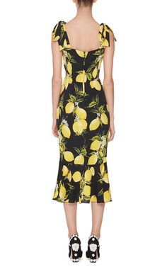 Bow shoulder detailing Ruffled hem Composition: 94% silk, 6% Lycra® spandex Lining: 94% silk, 6% Lycra® spandex most renowned design duo use their intricate, finely crafted collections to celebrate a spirited vision of womanhood. This **Dolce & Gabbana** dress features their signature feminine sheath silhouette with a vibrant lemon print, and is crafted with a stretch silk lining for impeccable fit and comfort.