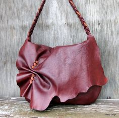 Rustic Lover's Natural Edge Shoulder Bag in Burgundy Oxblood Leather  by Stacy Leigh. $185,00, via Etsy.