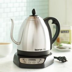 An electric tea kettle by Bonavita with an elegant curved spout and 6 different temperature settings.