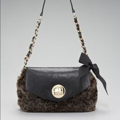 "Kate Spade Leopard Faux Fur Charcoal leopard print faux fur with black pebbled leather and golden hardware. Chain shoulder strap interwoven with leather with 12"" drop. In excellent condition. kate spade Bags Shoulder Bags"