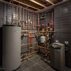 Functional Looking Mechanical Room | Sometimes the service spaces in a building are really fascinating and quite beautiful. What if they were more visible to the served spaces? I could see all that copper piping as being quite the art statement!