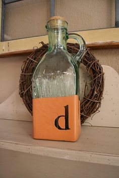 paint dipped glassware: apply craft sticker initial or word; dip glassware in paint; peel off sticker; voila, instant personalized decor!  These would be great gifts.  Also, another great way to recycle jars and bottles!