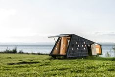 Experience Wood in Nature: Wooden Cabins on Denmark's Coasts - DETAIL - Magazine of Architecture + Construction Details Timber Cabin, Sea Pictures, Wooden Cabins, Small Buildings, Prefab Homes, Cabana, Architecture Design, Outdoor Structures, House Design