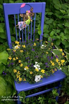 A bright old chair as a planter stand.