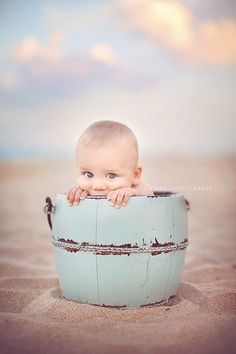Love the colors and tones of this picture!! but my favorite part is the little cutie in the bucket :)