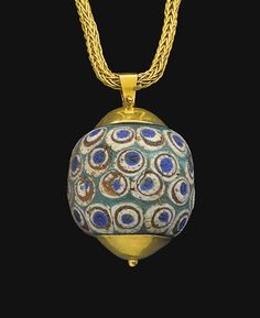 A PHOENICIAN OR CARTHAGINIAN GLASS BEAD CIRCA 4TH CENTURY B.C.