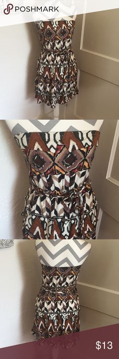 Poema Tiered tribal dress  Tribal print dress  Ties at waist purchased at Francescas   size medium Please ask for additional pictures, measurements, or ask questions before purchase No trades or other apps. Ships next business day, unless otherwise noted in my closet Reasonable offers accepted  Five star rating Bundle for discount Poema Dresses