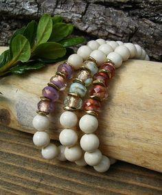 A sparkling bracelet set in lilac, blue, and rose gold.