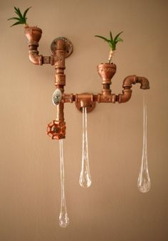Liquid Lights and planter out of plumbing fixtures.