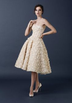 Ignoring the wedding dress article, I love the 1950s shape of this gown. Paolo Sebastian Couture FW 2015