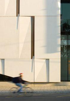 john wardle architects hawke building copper inlay on facade to drip verdigree onto white concrete4