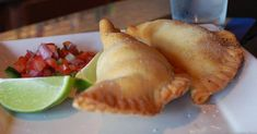 "An EMPANADA is a stuffed bread or pastry baked or fried in many countries in Latin America. The name comes from the Spanish verb ""empanar"" meaning to wrap or coat in bread. Empanadas are made [. Easy Cooking, Healthy Cooking, Cooking Recipes, Easy Dinner Recipes, Holiday Recipes, Easy Meals, Pasta Al Curry, Chicken Empanadas, Cuban Dishes"