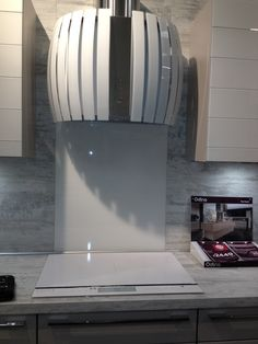 Induction hob and hood in white. Really nice from homebase