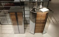 ala drawers cabinet with alluminio bronzo structure, top in bronzo mat glass, doors in clear reflective glass and walnut drawers
