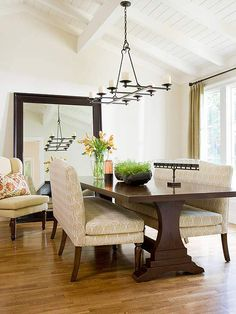 Unexpected Touches Banquet Seating Adds Coziness To This Formal Dining Room While An Oversize Mirror