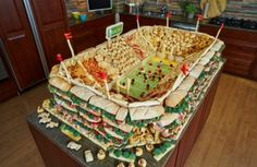 Game Day Food Coma-  Great idea from a previous party....for a smorgasbord of food waiting to be discovered, from cakes to candy's, ginormous sandwiches to blue crab.