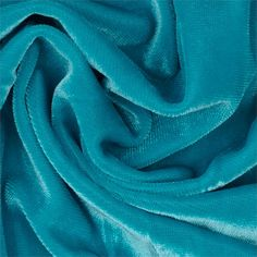 Stretch Velvet Knit Turquoise from @fabricdotcom  Turn heads in this luxurious medium weight velvet fabric.  Fabric has an ultra soft hand and 4 way stretch, knit backing and 40% stretch across the grain for added movement.  This stylish fabric is perfect for tops, skirts, dresses, dancewear and more.  Fabric has an subtle sheen for an added touch of sparkle!