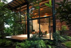 Open air living space connected to a deck surrounded with the greenery of Valle de Bravo, Mexico Design Jungle House, Forest House, Forest Girl, House In Nature, House In The Woods, Small Modern Home, Small Modern House Exterior, Dream House Exterior, House Exteriors