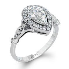 Style TR605, 0.30ctw round white diamonds and 0.66ctw mosaic diamonds (center stone consists of two diamond pieces) set in 18k white gold, starting at $2,970, Simon G