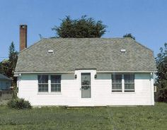 Drab color and nonexistent landscaping gave this 1940s-era beach cottage in Sagaponack, N.Y., the look of a well-located shoebox. Fortunately, its new owner recognized the potential for charm. Because the roofing and siding of his weekend retreat were structurally sound, owner Tom Woodard could take advantage of inexpensive tools such as paint and perennials to give his house the face-lift it needed.