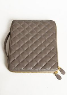 "Jeane Catherine Quilted IPad Case; Model: 469-70_543_9621; $29.99. Fashion forward and essential, this grey faux leather iPad case is an essential piece. Complete with a gold zipper closure and side handle. 8""Lx10""H. http://shopruche.com/jeane-catherine-quilted-ipad-case.html#NP=2d44ca9bd8040914cd89038a6ff7d6ab"