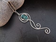 "Whimsical sterling silver ""ocean wave"" necklace with blue sea glass nugget"